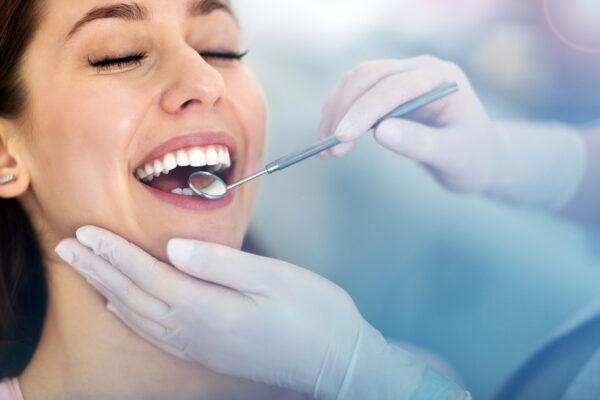 Woman having teeth examined at dentists